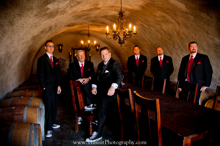 groomsmen inside wine chamber by top wedding photographer