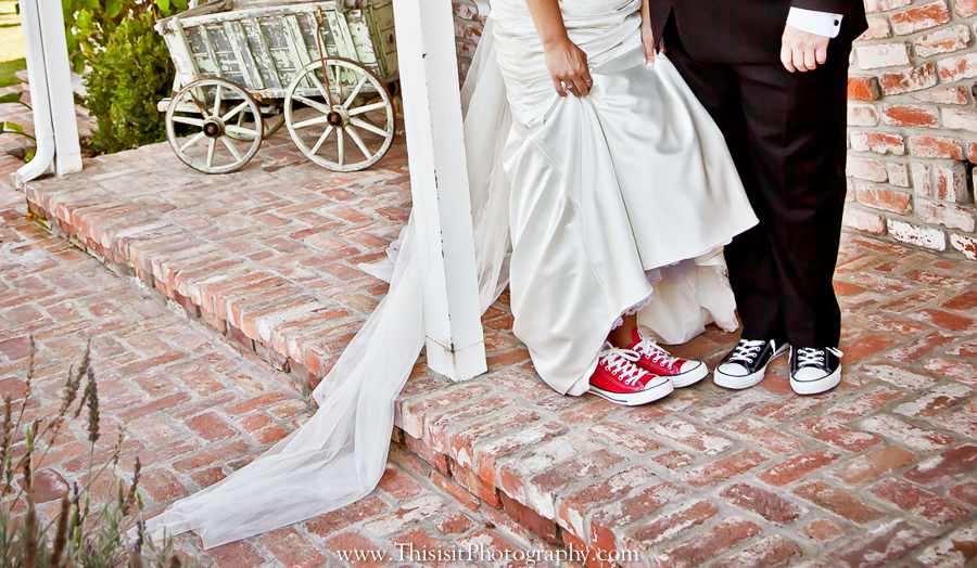 bride and groom with sneakers pictured by this is it photography