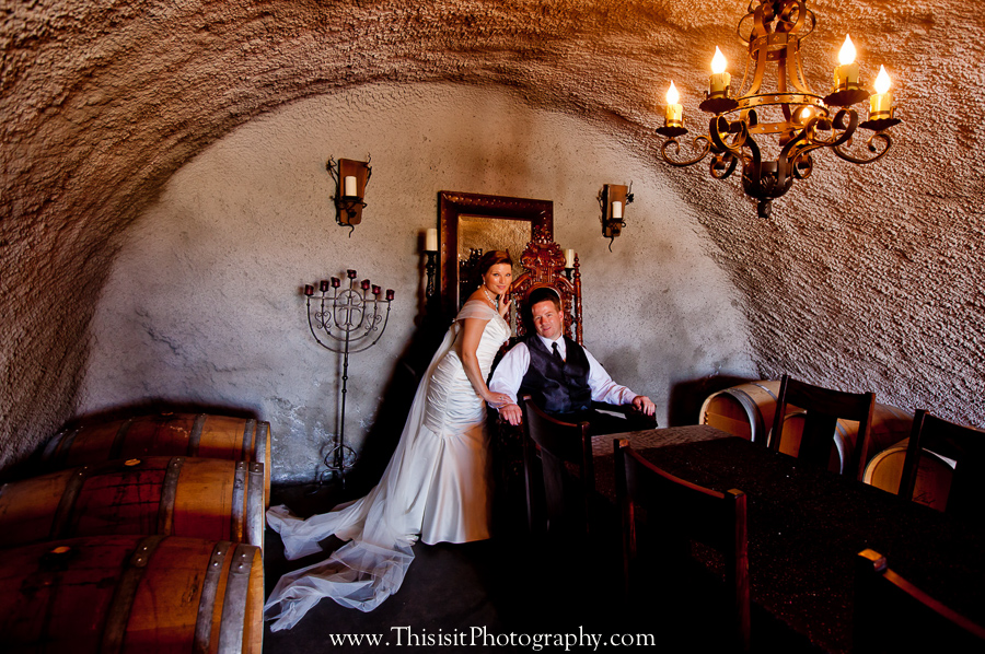 bride and groom wedding photographer inside wine chamber